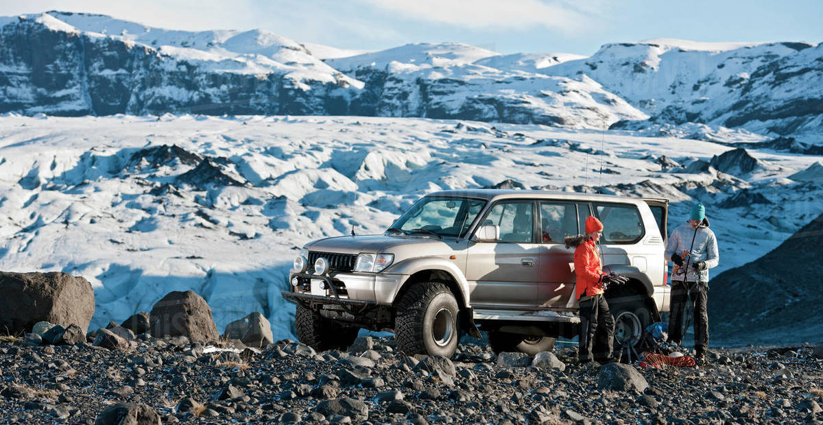 Young couple getting ready to hike from their SUV in Iceland Royalty-free stock photo