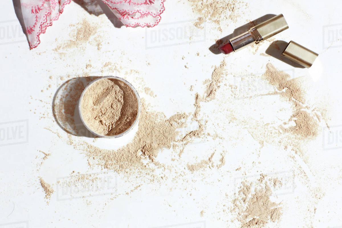Still life of lipstick powder spill Royalty-free stock photo