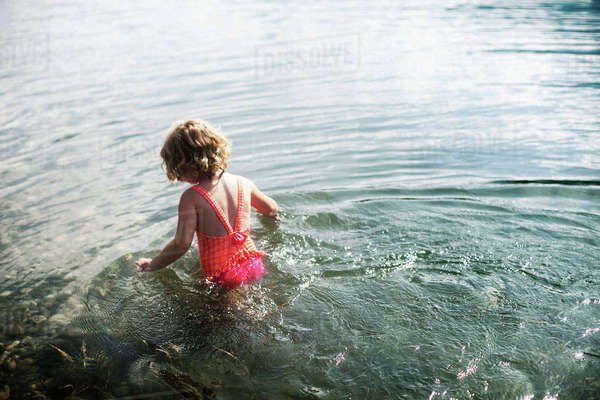 Rear view of girl in sea on sunny day Royalty-free stock photo