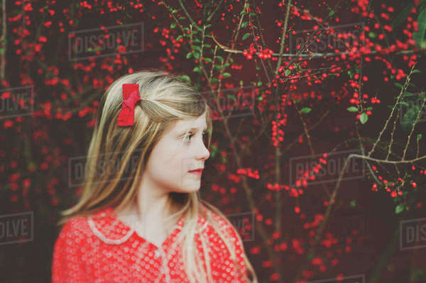 Thoughtful cute girl against plants Royalty-free stock photo