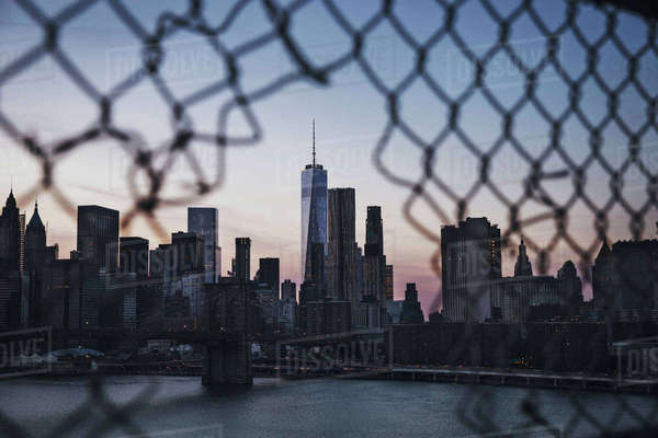 One World Trade Center seen through broken chainlink fence Royalty-free stock photo