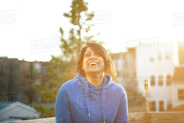 Young woman in blue sweatshirt laughing Royalty-free stock photo