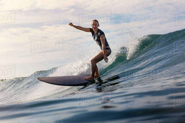 Carefree woman surfboarding on sea Royalty-free stock photo