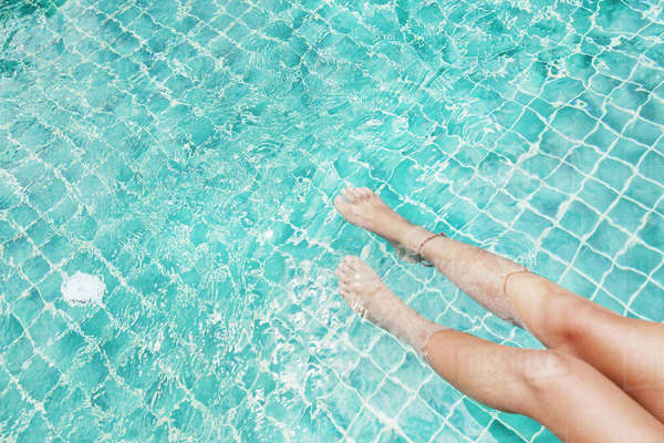 Low section of sensuous woman in swimming pool Royalty-free stock photo