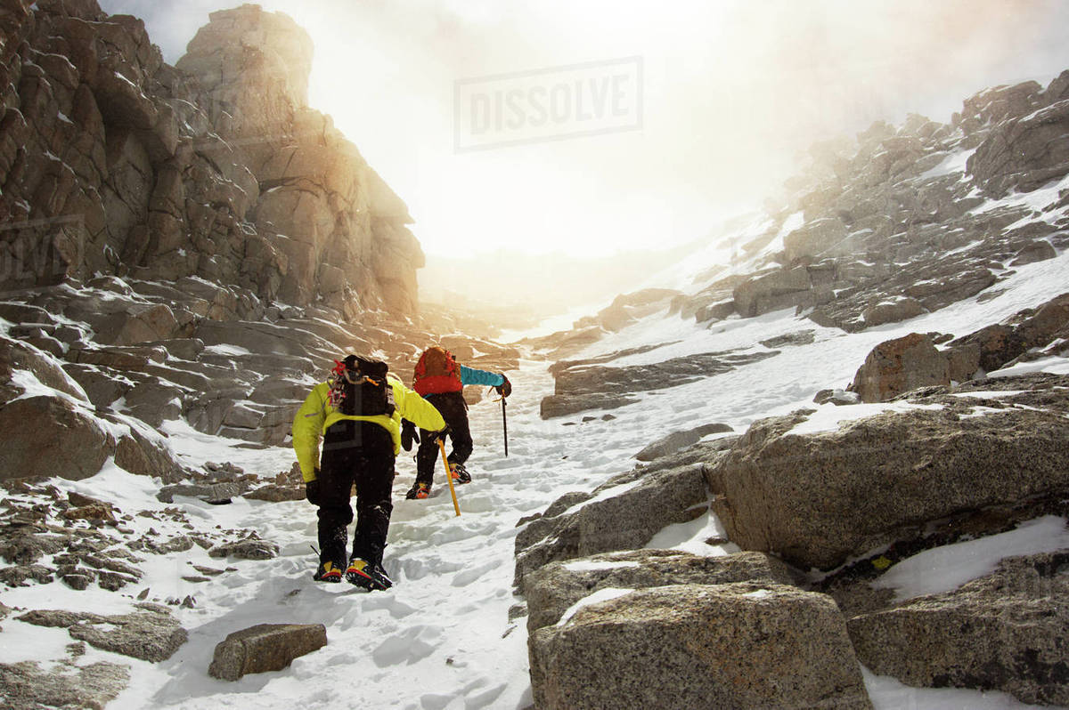 Low angle view of men hiking on snow covered Mount Whitney Royalty-free stock photo