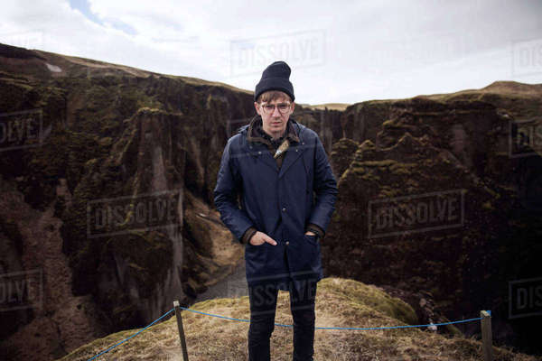 Portrait of confident man standing against mountains Royalty-free stock photo
