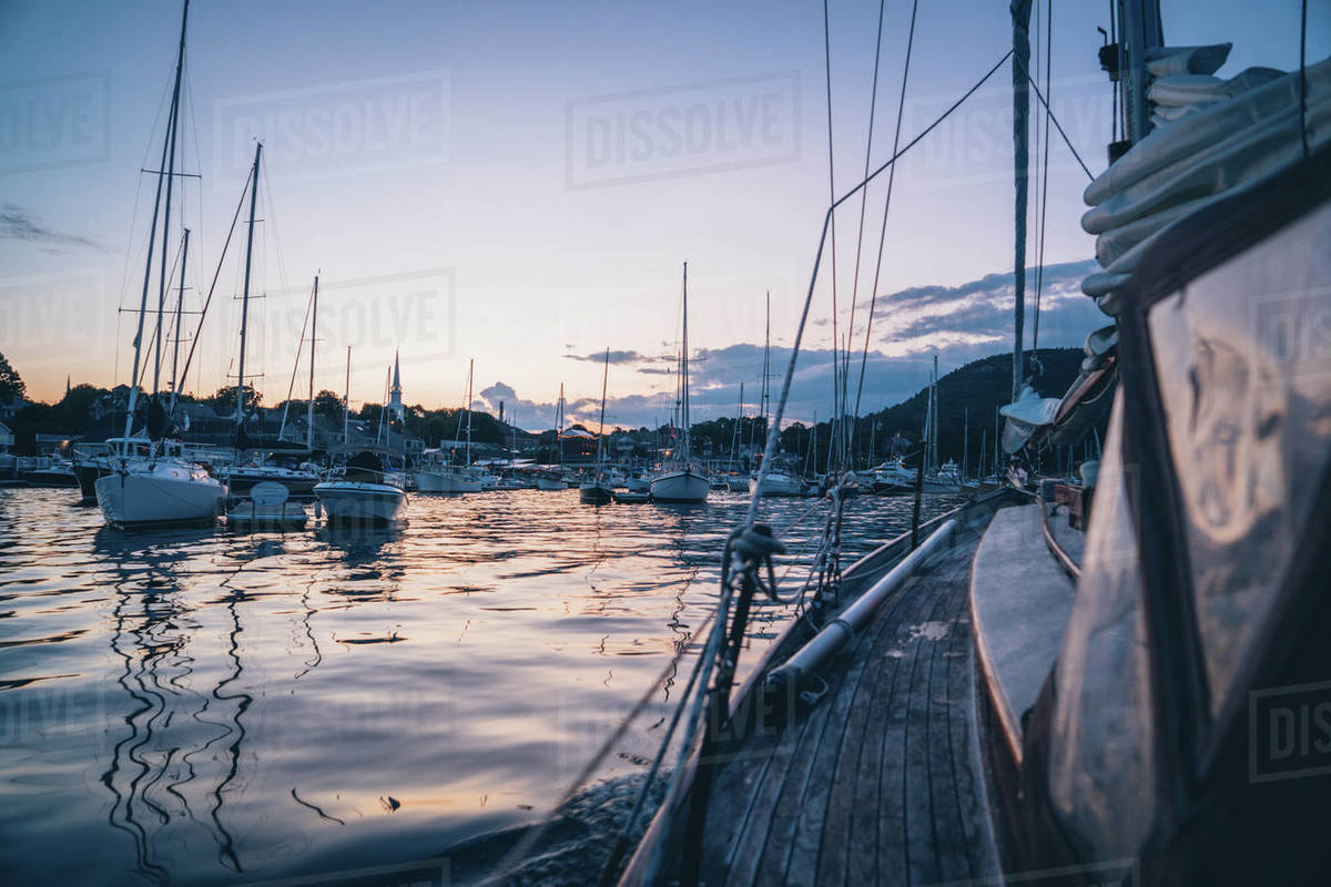 Sailing through the boats in Camden Harbor, Maine during blue hour Royalty-free stock photo