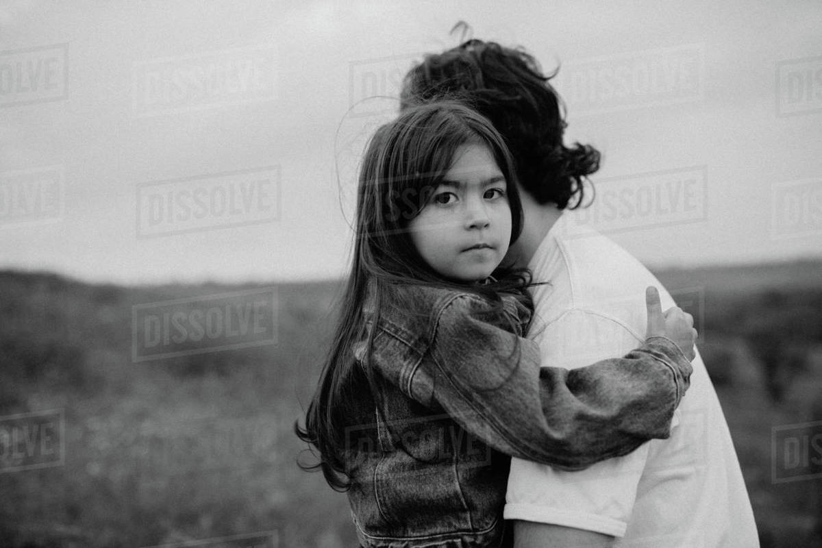 Portrait of girl being carried by father in field Royalty-free stock photo