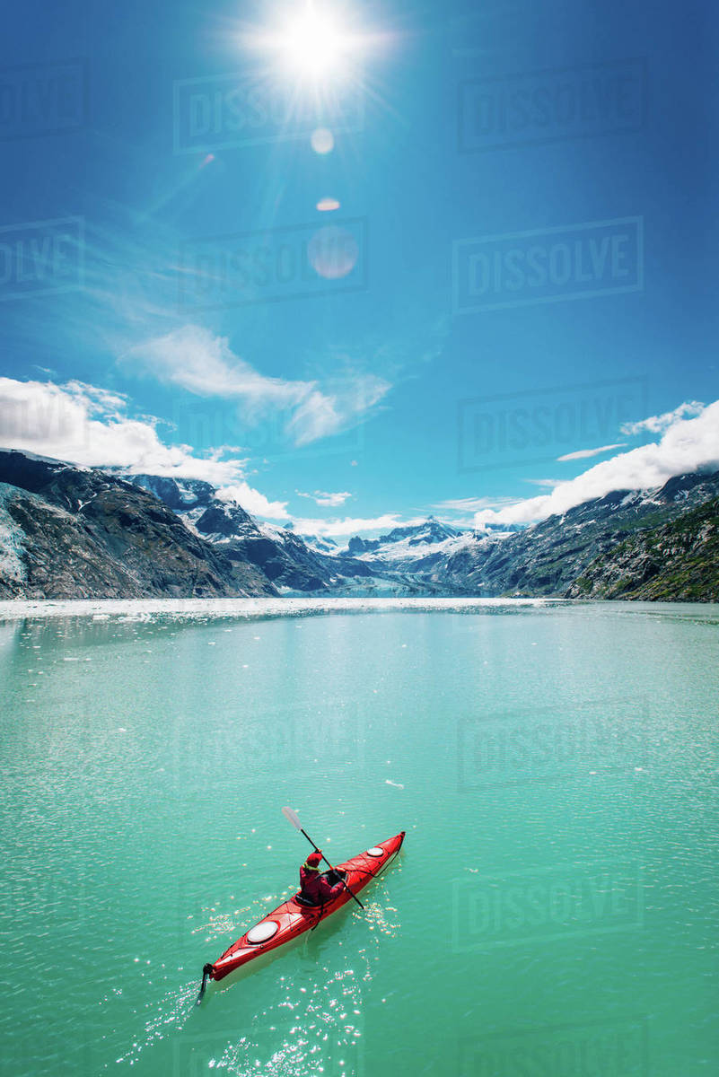 Woman kayaking in Glacier Bay National Park with glacier in background Royalty-free stock photo