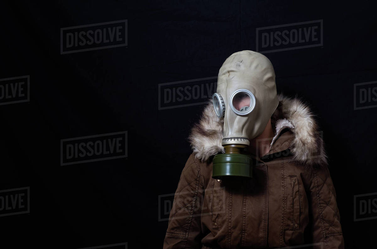Woman in coat and mask looking sad Royalty-free stock photo