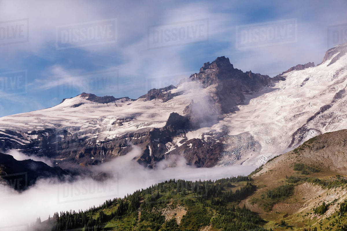 Snow and clouds accentuate the mountain textures of crevices and peaks Royalty-free stock photo
