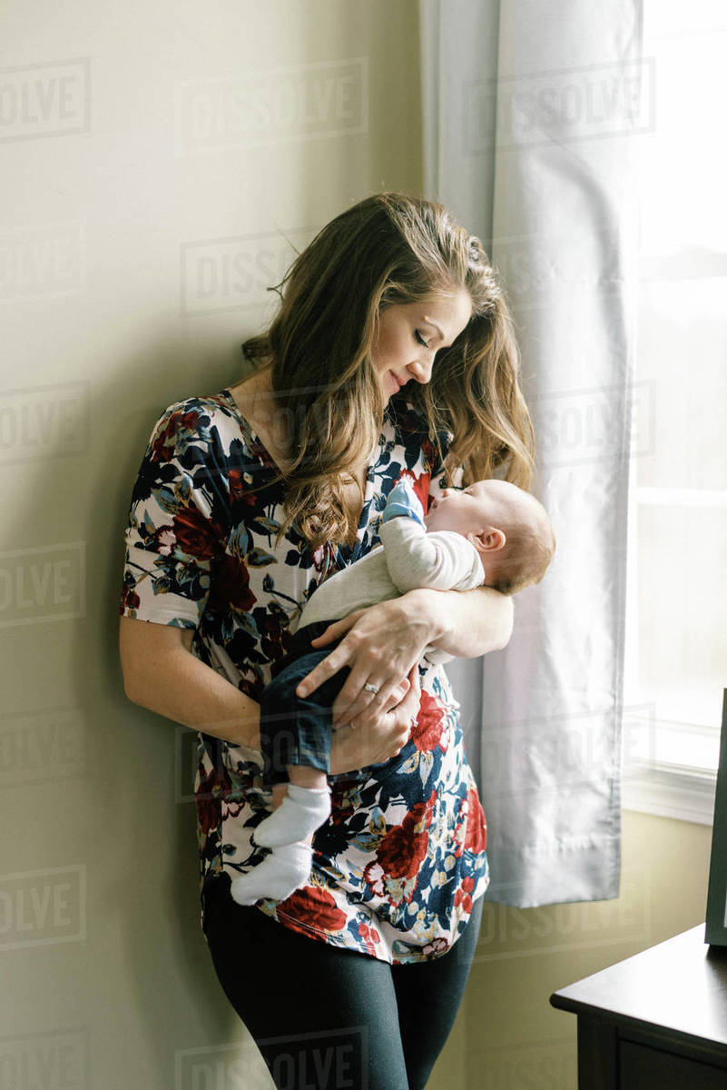 A new mother holding her newborn son with love and affection Royalty-free stock photo