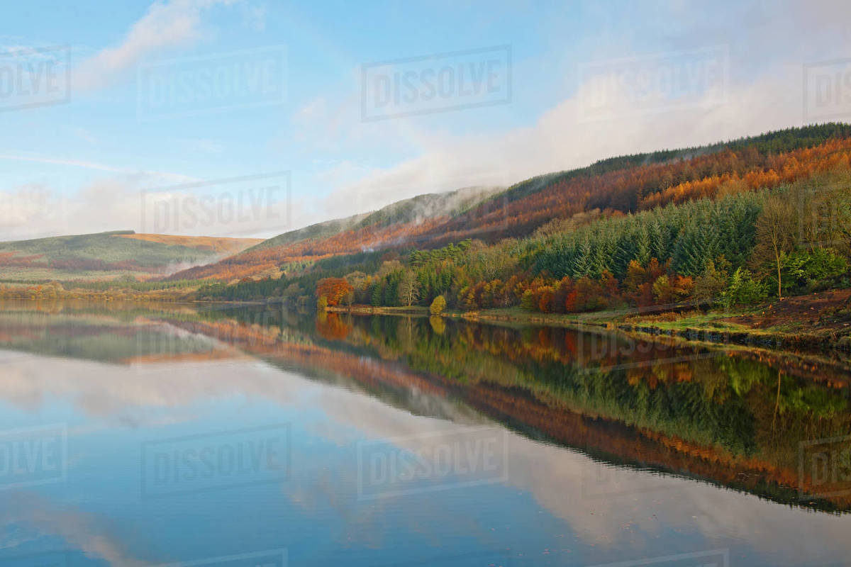 Autumn mist at still lake in the Brecon Beacons in South Wales Royalty-free stock photo