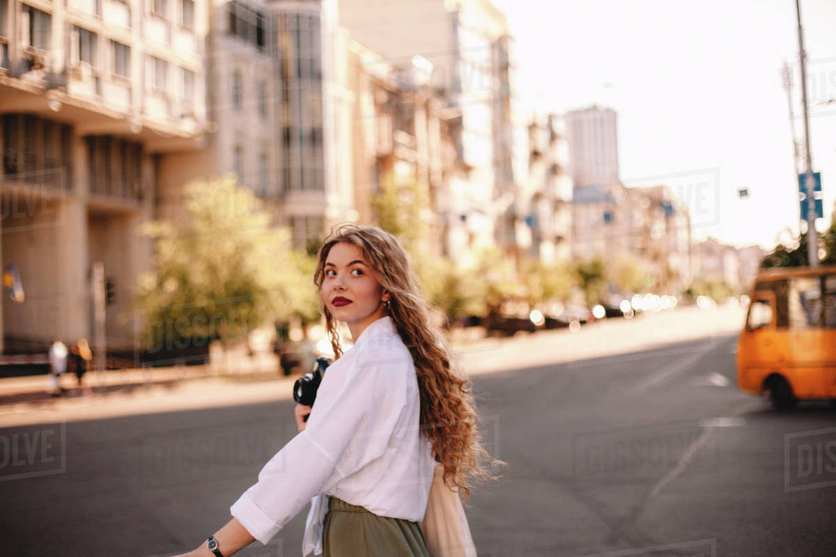 Young woman walking on city street during summer Royalty-free stock photo