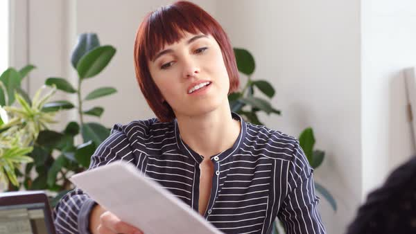 Businesswoman discussing with female colleague in creative office Royalty-free stock video
