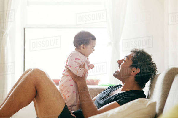 View of father playing with daughter (2-5 months) Royalty-free stock photo