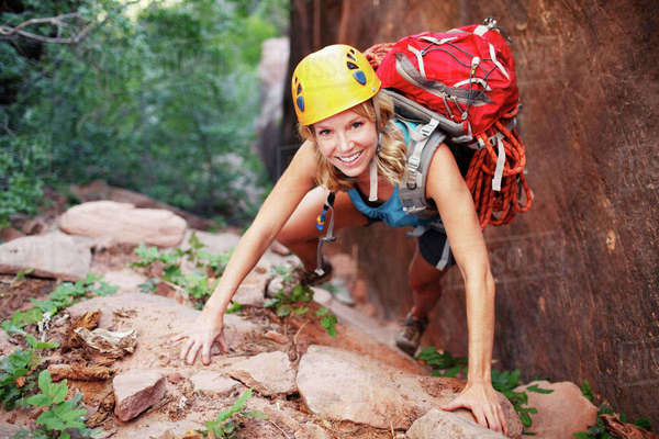 Portrait of confident female climbing mountain Royalty-free stock photo