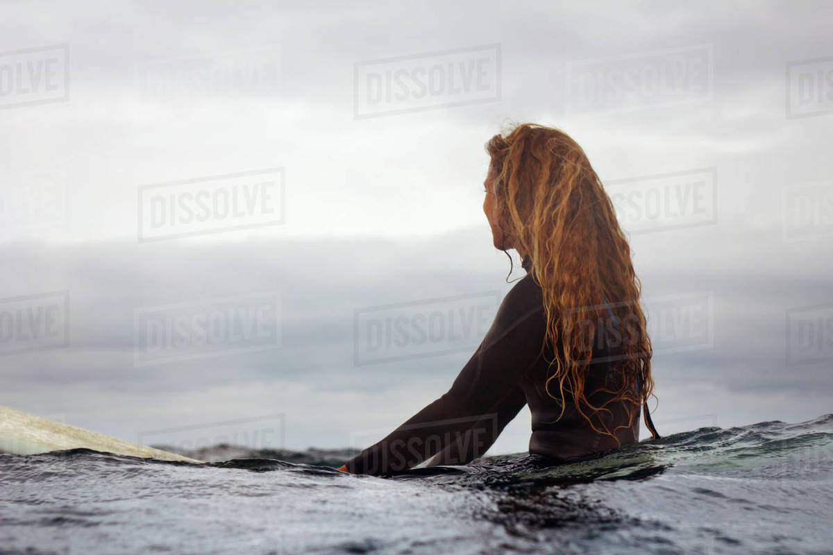 Woman with surfboard in sea against sky Royalty-free stock photo