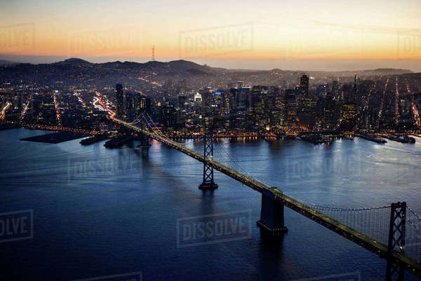Aerial view of Bay Bridge and illuminated cityscape during sunset Royalty-free stock photo