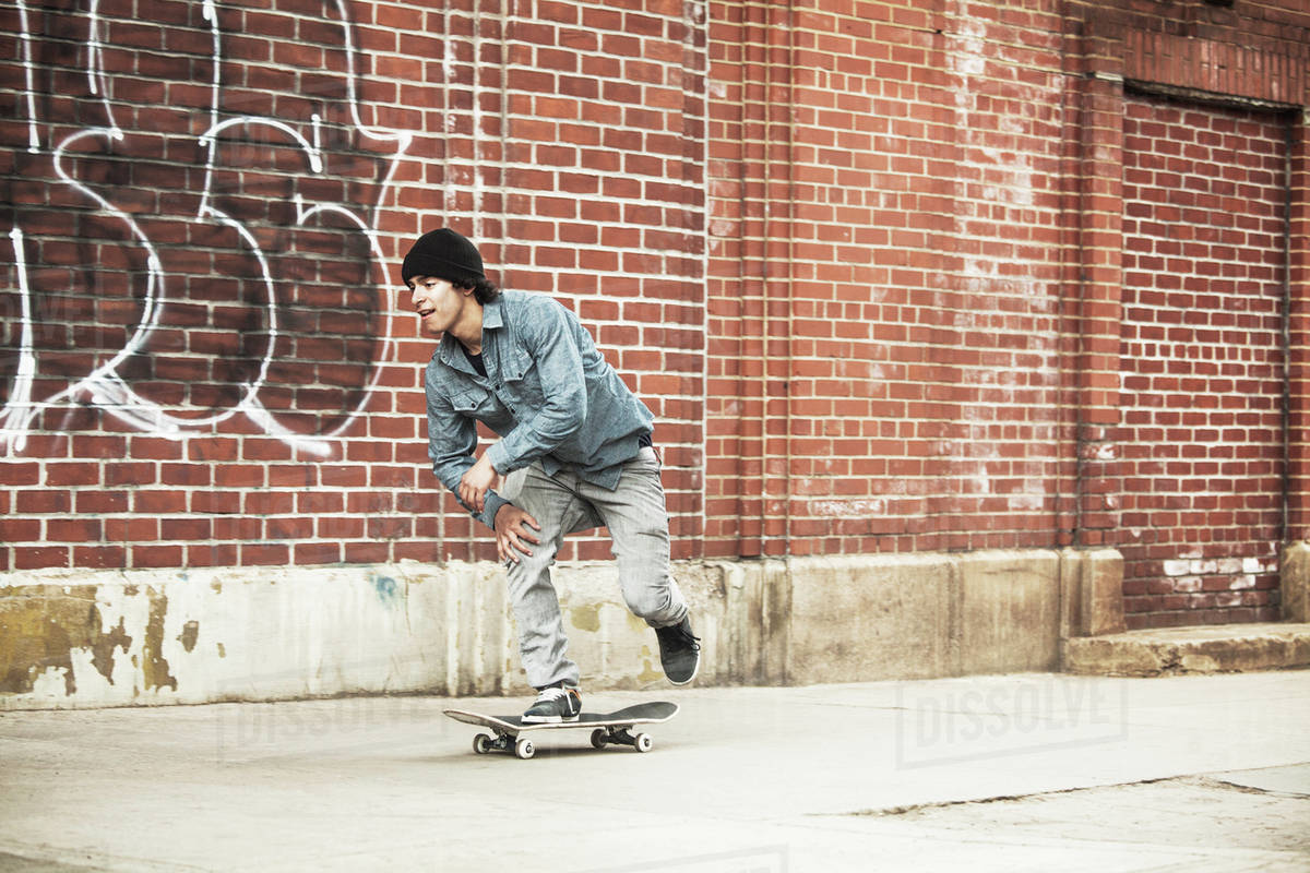 Young man skateboarding, Royalty-free stock photo