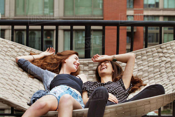 Young women relaxing in hammock Royalty-free stock photo