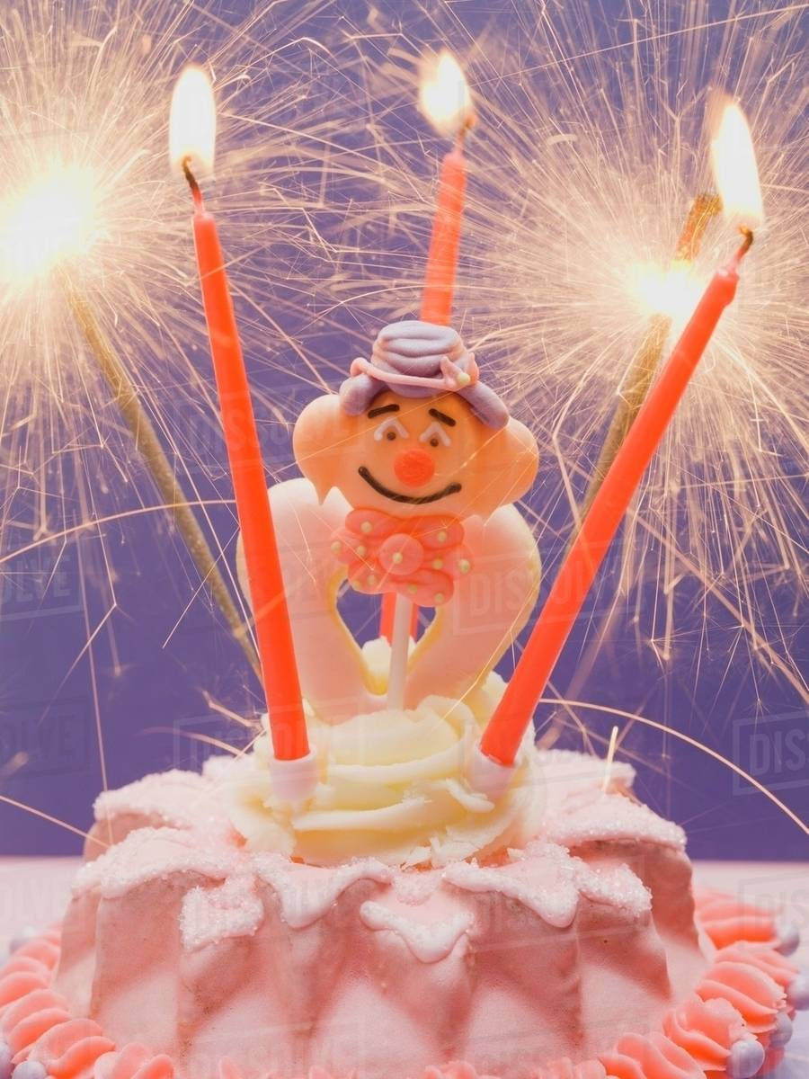Small Cake With Clown Sparklers For Childs Birthday