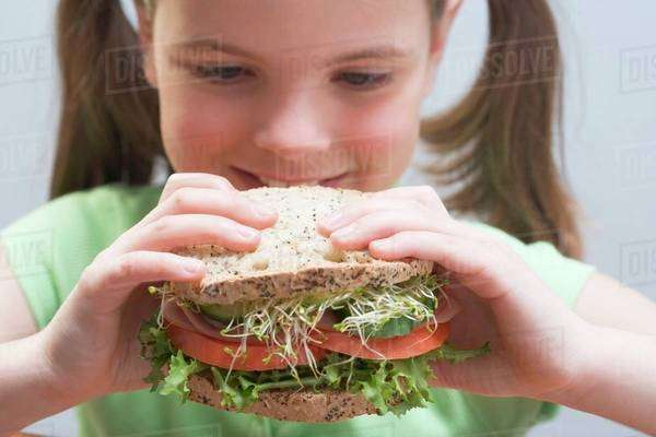 Girl with large sandwich Royalty-free stock photo