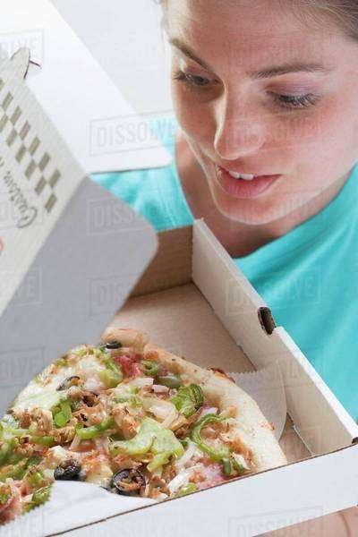 Woman with fresh pizza in box Royalty-free stock photo