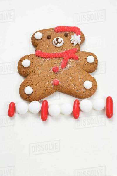 Christmas biscuit (teddy bear) and sweets Royalty-free stock photo