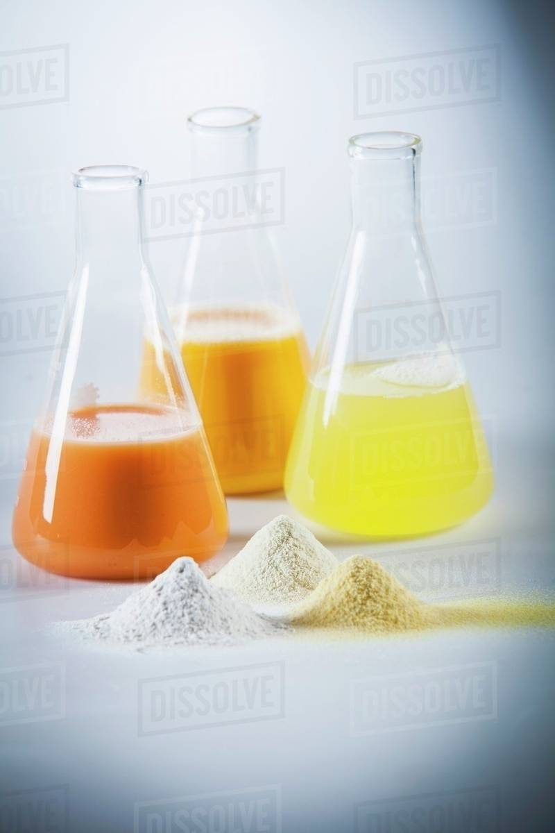 Egg yolk, egg white and mixed egg in laboratory flasks and as powder stock  photo