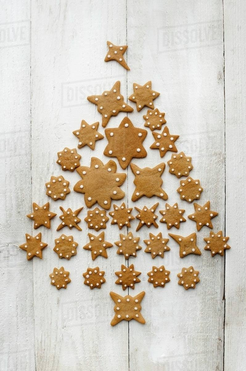 A Christmas Tree Made From Star Shaped Gingerbread On A Light Wooden Surface Stock Photo