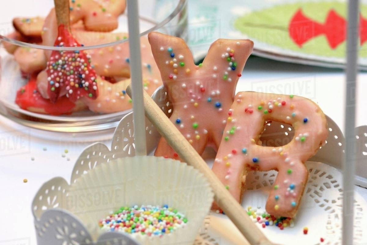 Letter Shaped Christmas Biscuits Decorated With Sugar Sprinkles Stock Photo