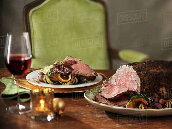 Festive roast beef with roasted vegetables Royalty-free stock photo