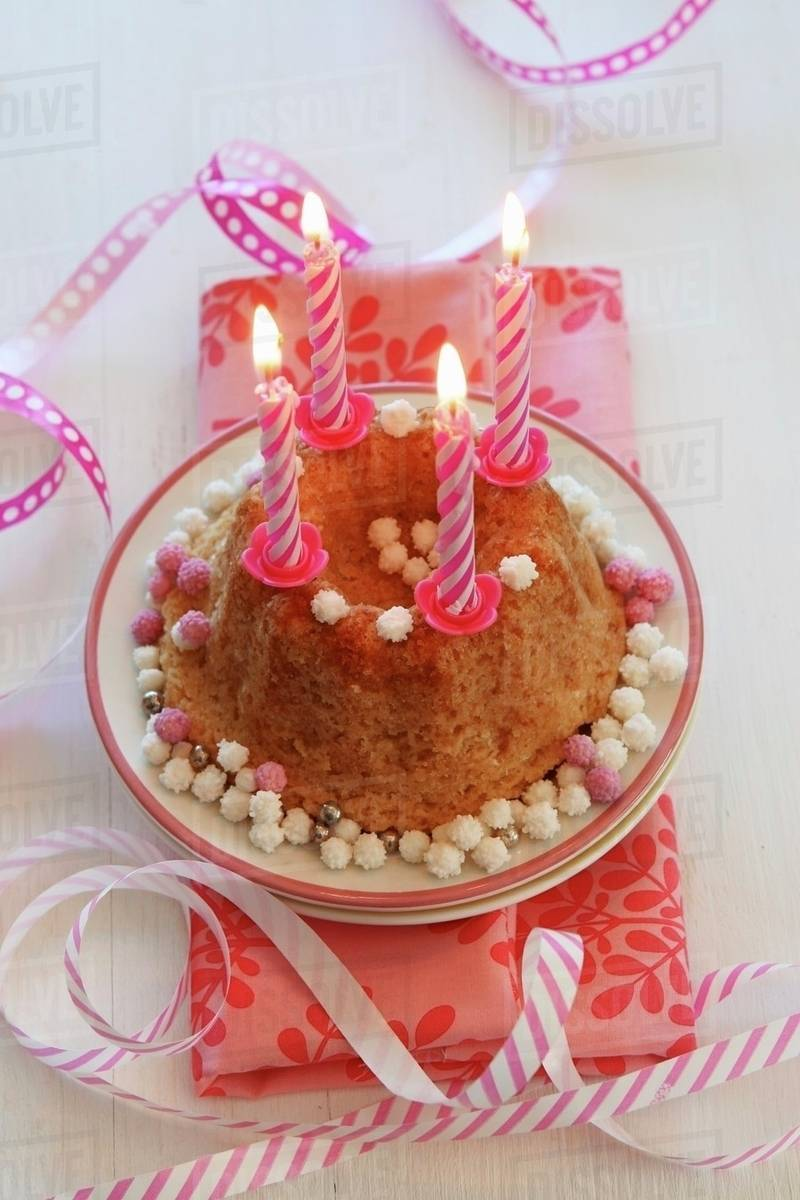 Marvelous A Small Birthday Cake With Lit Candles And Streamers Stock Photo Funny Birthday Cards Online Elaedamsfinfo