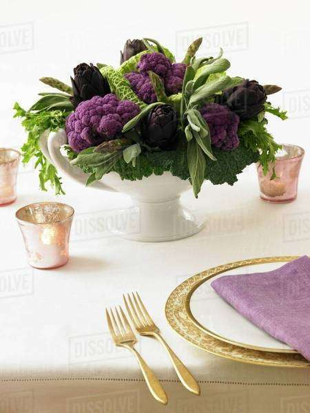Table Centerpiece Made from Purple Artichokes and Cauliflower Royalty-free stock photo