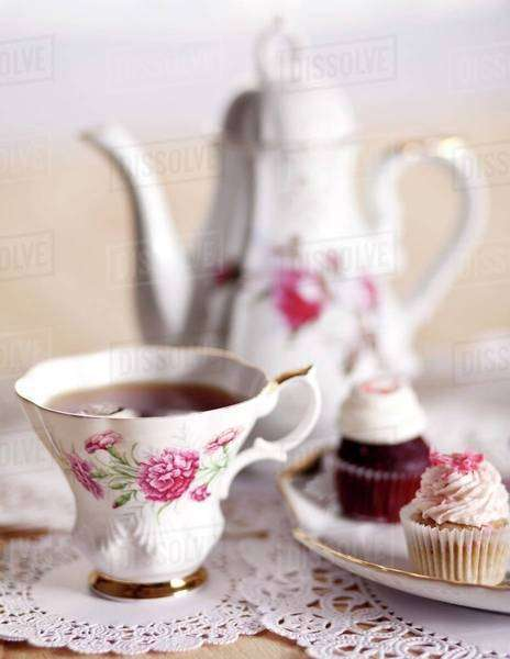 Pretty Antique Tea Cup with Mini Cupcakes and Tea Pot Royalty-free stock photo