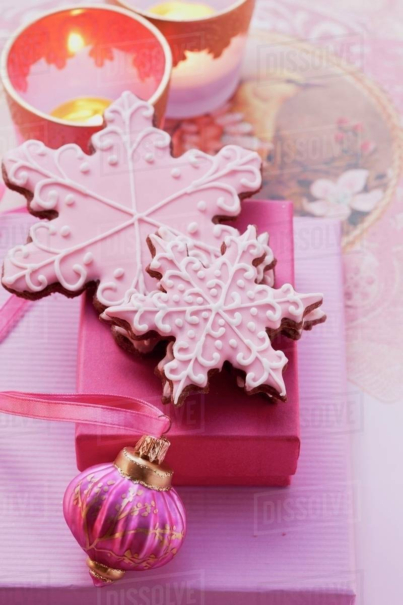 Christmas Biscuits Decorated With Pink Icing As A Gift Stock Photo