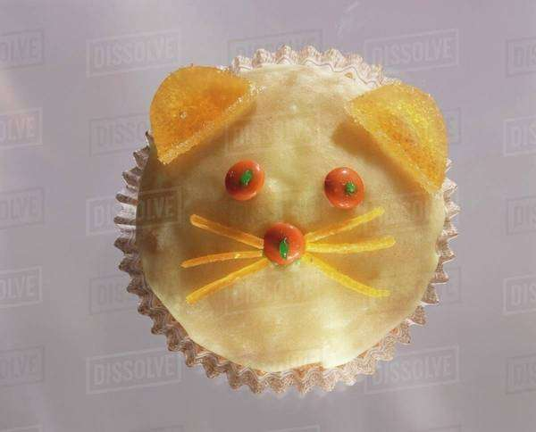Decorated muffin (cat's face) Royalty-free stock photo