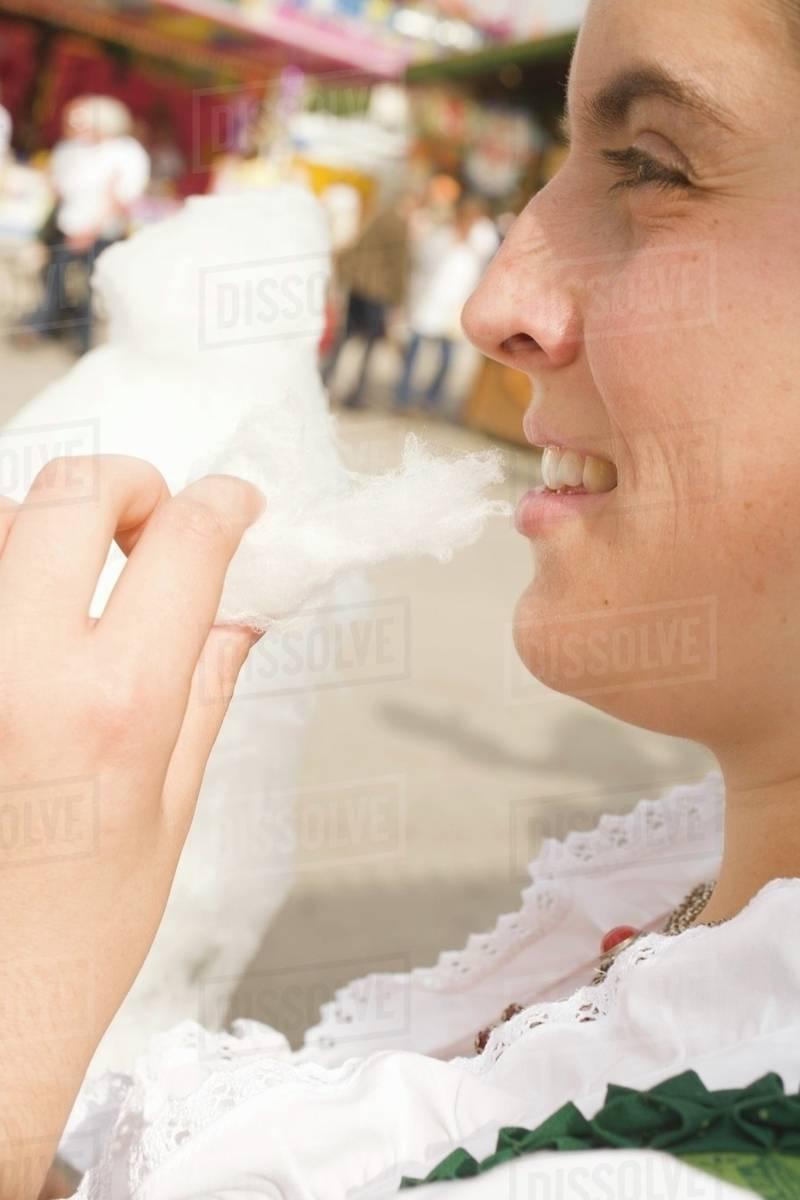 Woman eating candyfloss (Oktoberfest, Munich) Royalty-free stock photo