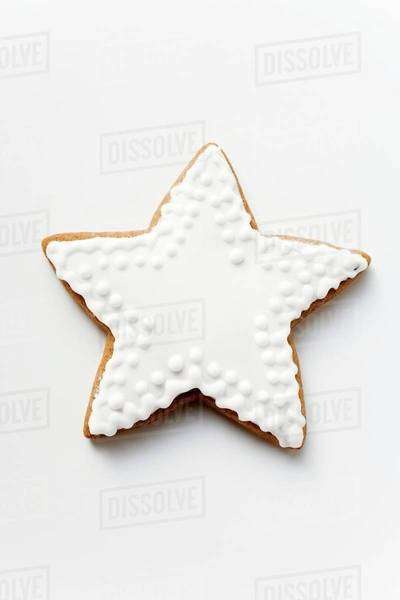 Gingerbread star with white icing Royalty-free stock photo