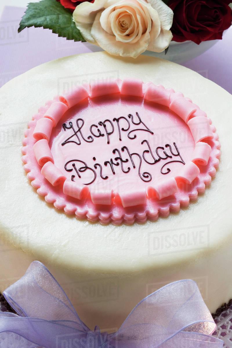 Birthday Cake On Pale Purple Box Roses Close Up Stock Photo