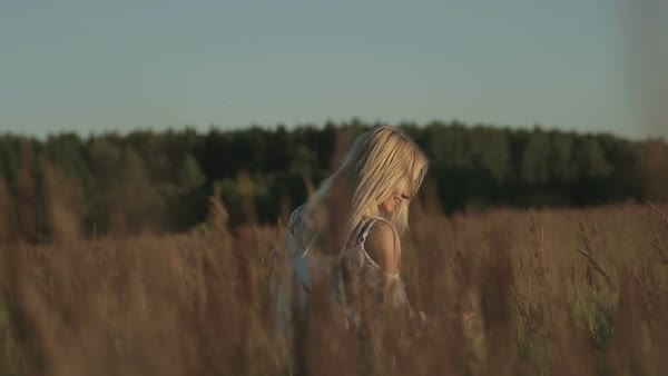 Girl in the field. walking near the forest Royalty-free stock video