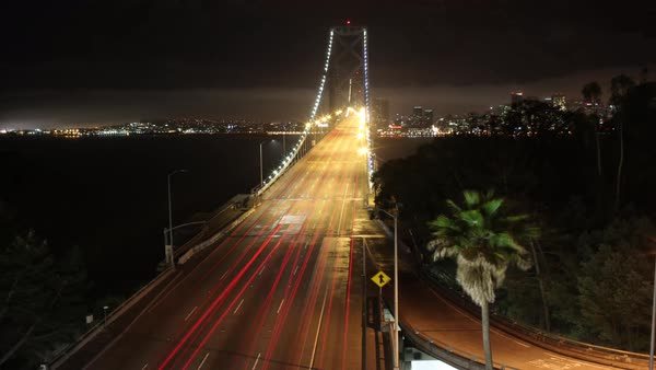 Wide shot of San Francisco-Oakland Bay Bridge at night in San Francisco CA, USA Royalty-free stock video