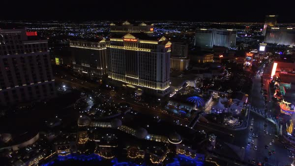Aerial shot of Caesars Palace and the Las Vegas Strip at night Royalty-free stock video