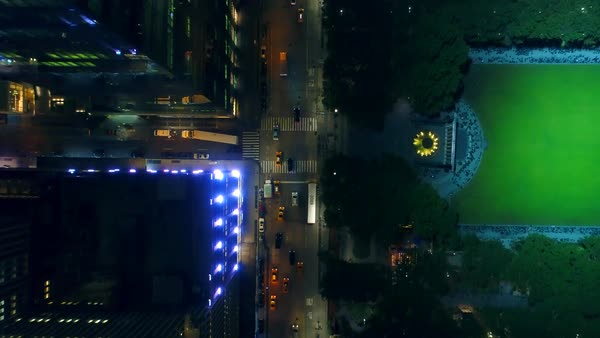 Wide aerial shot over 6th Ave in New York City at night Royalty-free stock video