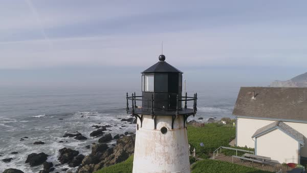 View of a lighthouse and houses near Half Moon Bay Royalty-free stock video