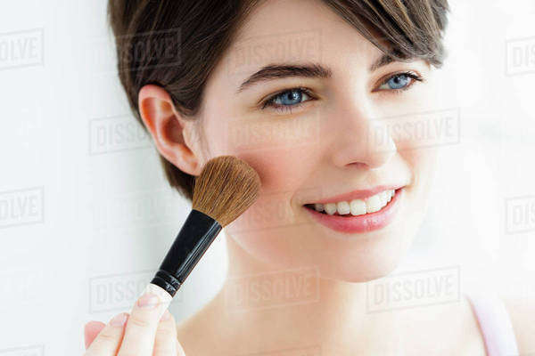 Germany, Bavaria, Munich, Young woman using blusher brush, close up Royalty-free stock photo