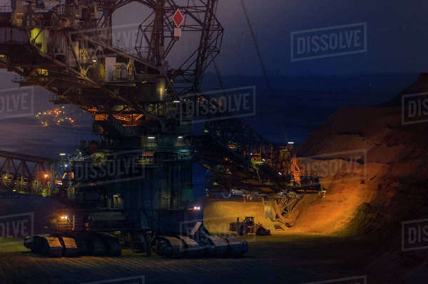 Germany, Grevenbroich, brown coal mining Garzweiler, Bucket-wheel excavator at night Rights-managed stock photo