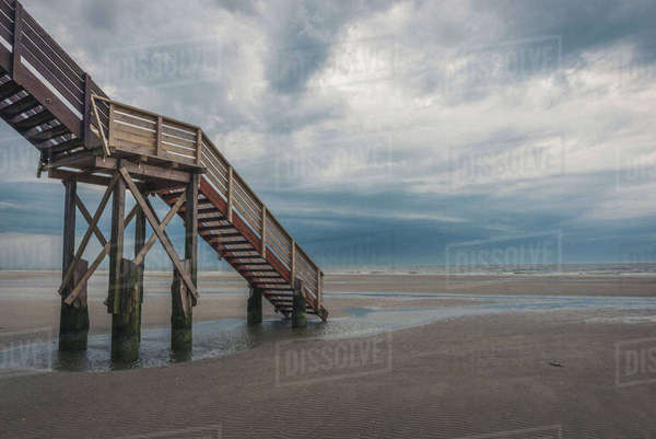 Germany, Schleswig-Holstein, St Peter-Ording, beach and staircase Rights-managed stock photo