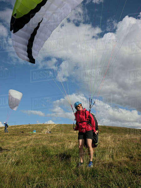 Smiling paraglider enjoying sunlight Rights-managed stock photo